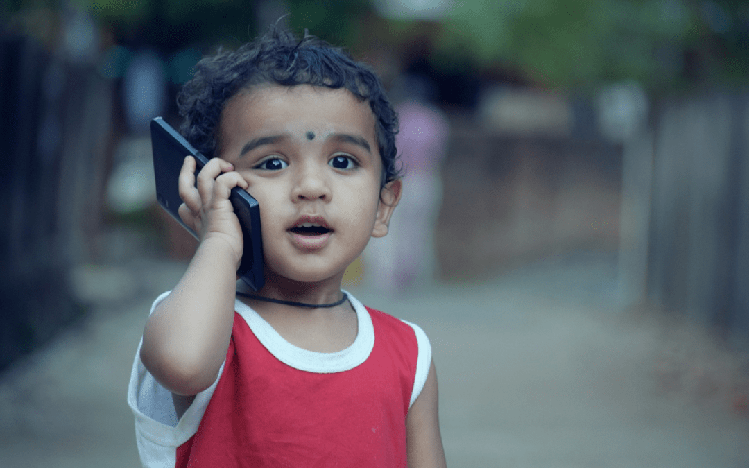 little Indian boy on the phone