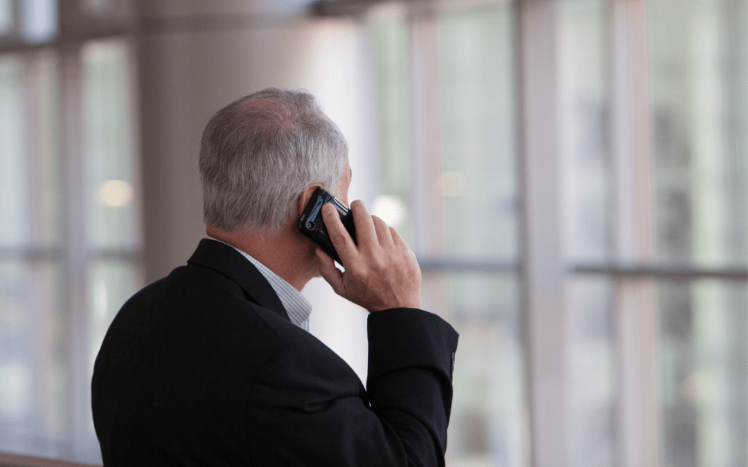 man in business suit calling on the phone